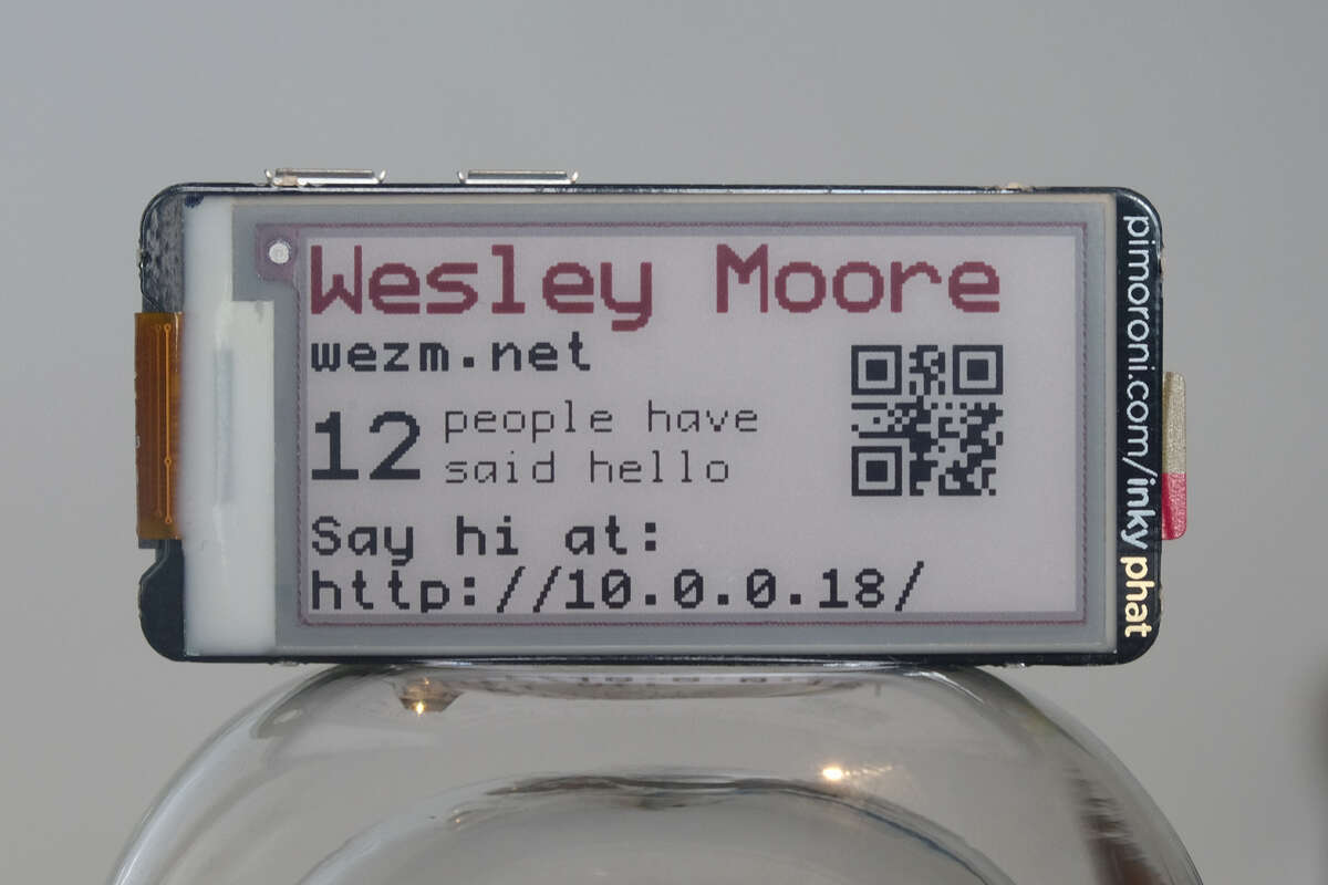 My Rust Powered linux conf au e-Paper Badge - WezM net by