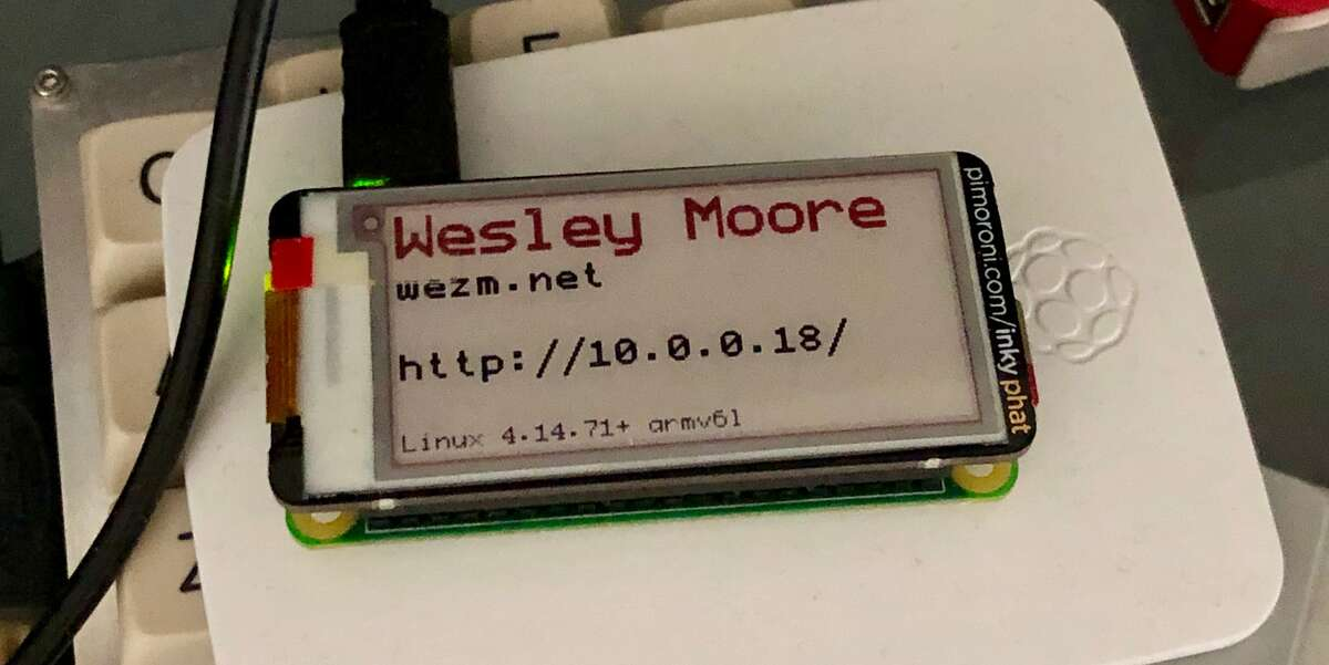 An early revision of the badge from 6 Jan 2019 showing my name, website, badge IP, and kernel info.