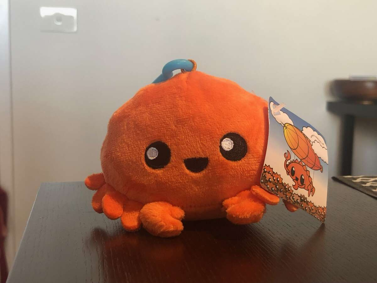 Photo of a small orange plush crab.
